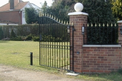 Spiked driveway gate